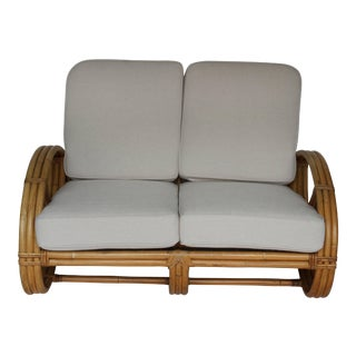 Rattan Pretzel Loveseat in the Style of Paul Frankl For Sale