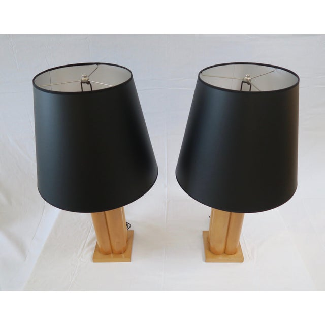 Pair of Maple carved column table lamps. New black paper shades with silver interior.