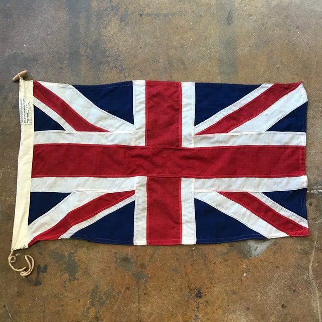 Vintage cloth stitched U.K. Union Jack flag with bright colors.