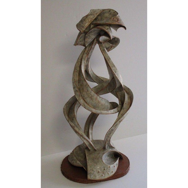 Light weight vintage metal sculpture. Thin possible aluminum metal with paint or added patina. Unsigned as shown. I was...