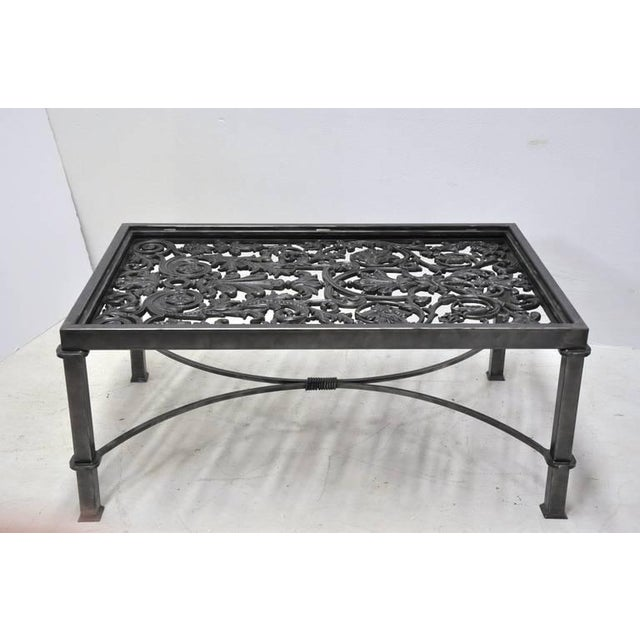This polished iron coffee table base is made using an ornate, antique gate from France, circa 1850. The table features...