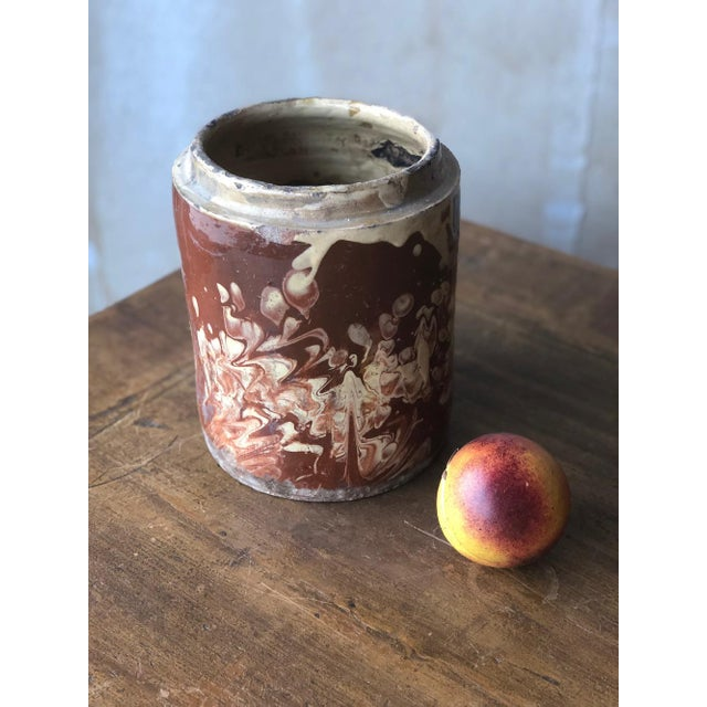 The ceramics from the region of Puglia, Italy have a very earthy feel. This Italian Pugliese cylinder shaped jar was once...