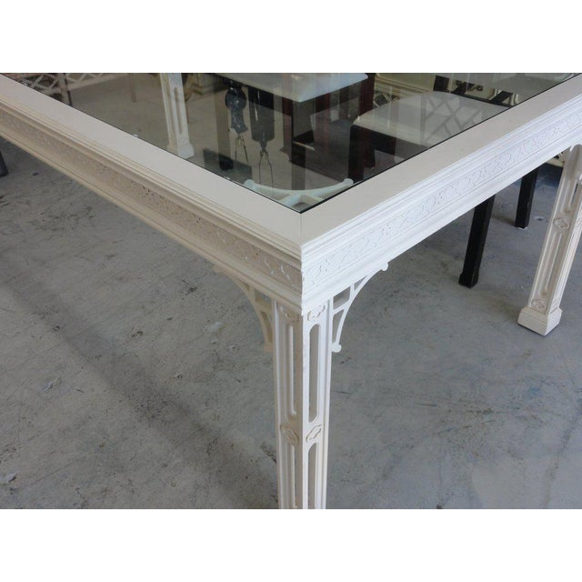 Palm beach fretwork dining table with glass top.