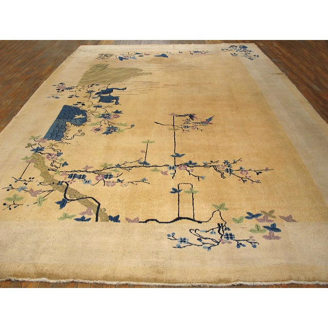 Antique Chinese Art Deco Rug with a beige background and patterned border.