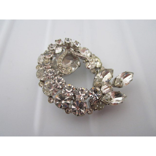 Single vintage Austrian rhinestone brooch. Circa: 20th Century Due to the unique nature of this product, all sales are...