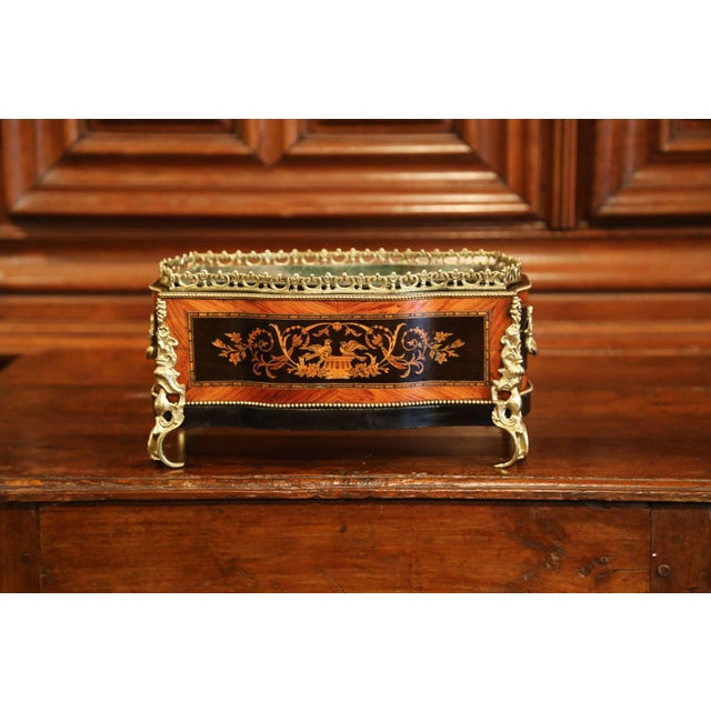 This beautifully crafted, antique fruitwood jardinière was crafted in Paris, France, circa 1870. Rectangular in shape with...