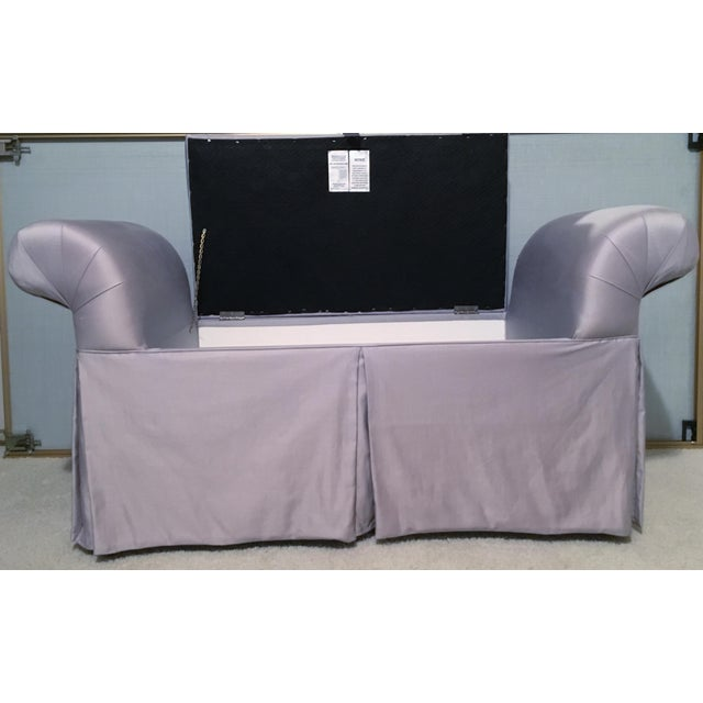 This is a very unique and very clean bench. The chaise lounge or bench has storage by lifting up the hinged seat. The...
