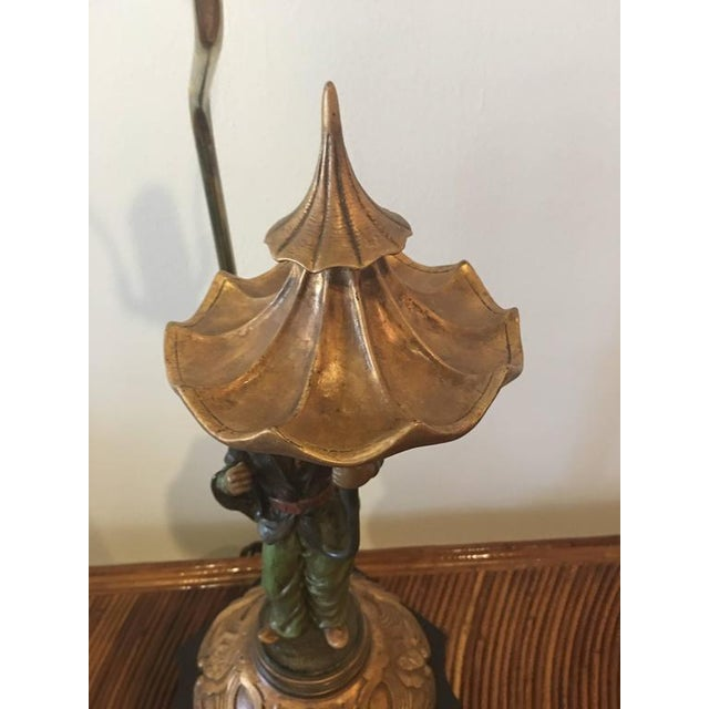 Lovely vintage chinoiserie oriental lamp holding a pagoda umbrella. Brass socket and finial, no lampshade. 23.5 to socket...