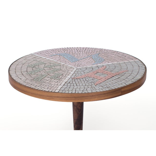 Mosaic tile and walnut side table, circa mid-1960s. This custom example has an intricate and stunning mosaic top and solid...