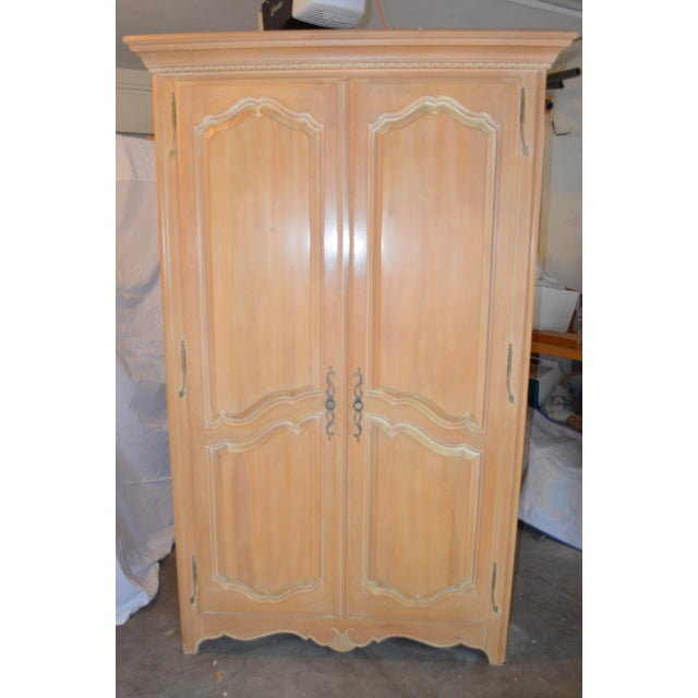 Beautiful Ethan Allen Country French armoire/wardrobe/TV cabinet. Natural maple with a subtle antique whitewash called...