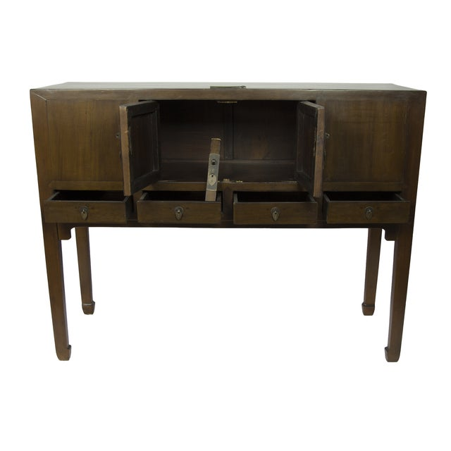 This is wonderful Shangdong sideboard circa 1890. It is finished in a warm walnut and has 2 doors and 4 drawers with...