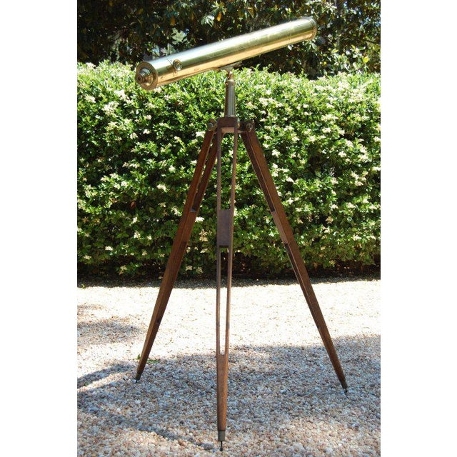 """Working brass telescope on mahogany tripod base. Signed """"Tho. Harris and Son Opticians to the Royal Family, 52 Gt. Russell..."""