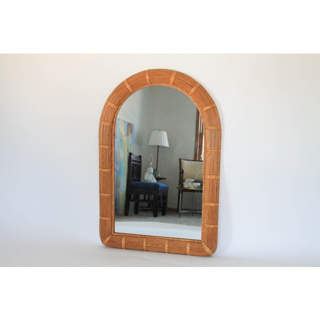 Vintage Boho-style arched wicker wall mirror. No makers mark. Minor age wear. Ready to hang.
