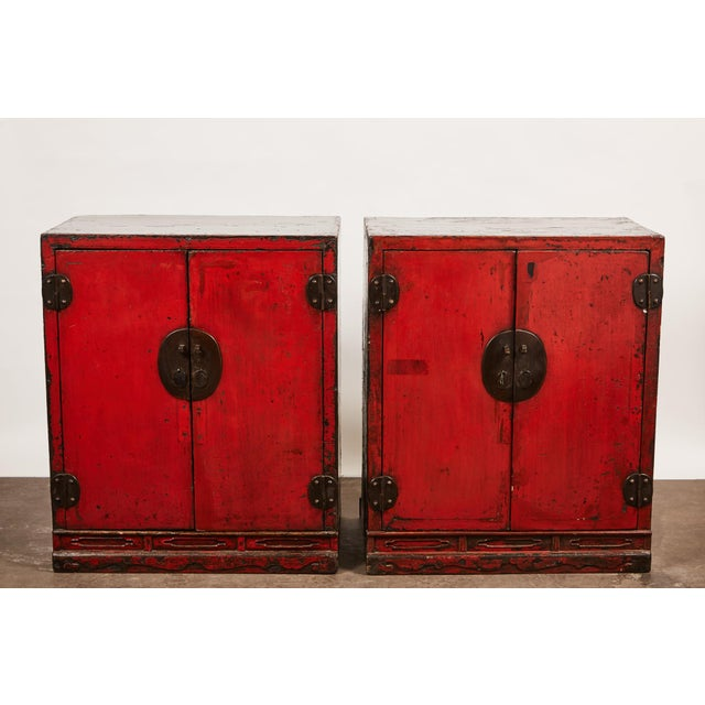 Pair of black lacquer and cinnabar faced two doof cabinets from () with good hardware. It is a rare piece.
