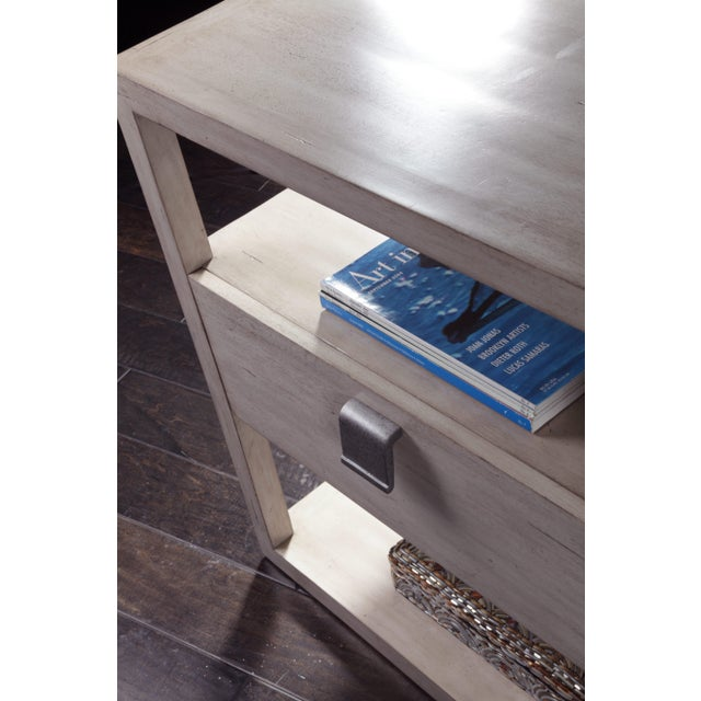 This nightstand from the Century Furniture Leeward Collection is crafted of Mahogany solids and veneers. A single soft-...