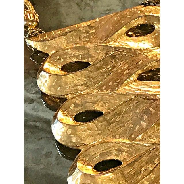 Striking gold gilt necklace from Sandor...beautiful scroll design pendant...multiple chain fringe dangles...double...