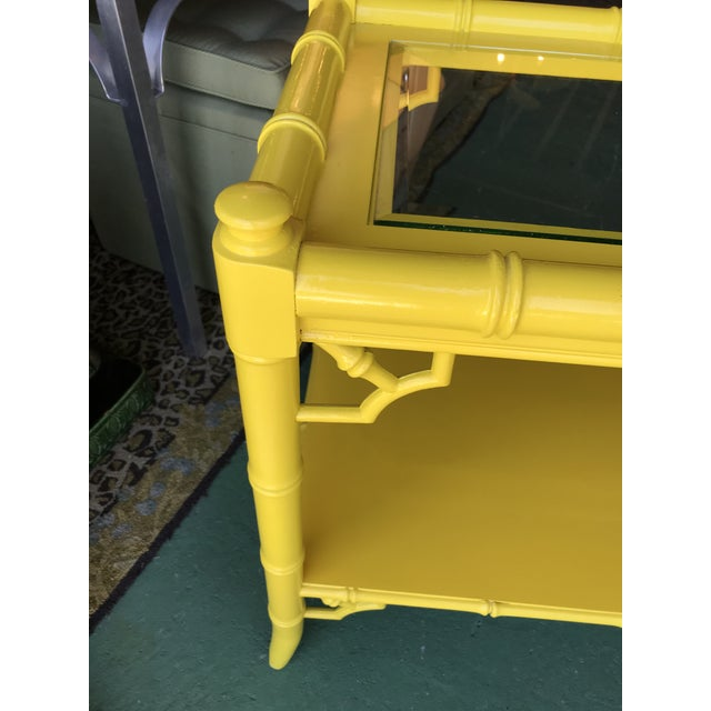 Faux bamboo and Fretwork console table Lacquered in a bright Florida sunshine yellow. There are some minor scuffs and...