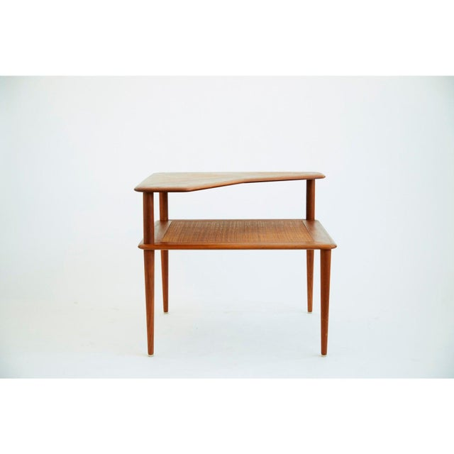 Teak and Cane Minerva side table by Peter Hvidt and Orla Mølgaard-Nielsen. First designed in 1961 and manufactured by...