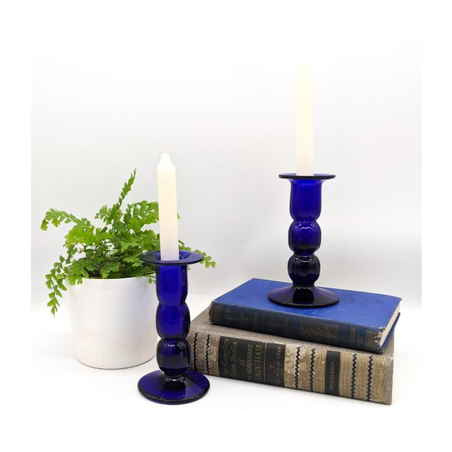 Stunning pair of brilliant cobalt blue candlesticks. Lovely, unique mid-century design. Perfect for holiday or everyday...