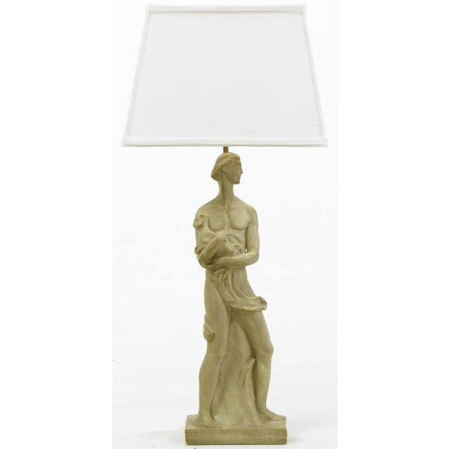 Statue of a Egyptian man holding a cat is the base and body of this early Chapman Manufacturing table lamp. Lamp body is...