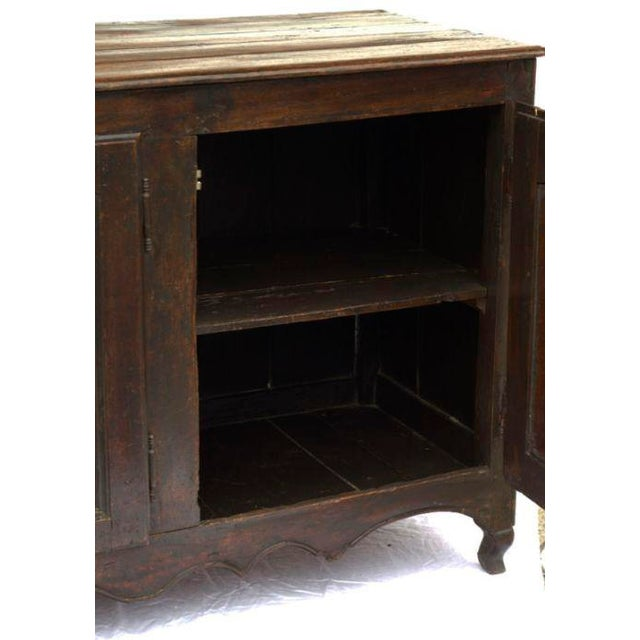 An early 19th Century French large and rustic oak enfilade or cabinet (sideboard). Recently polished.