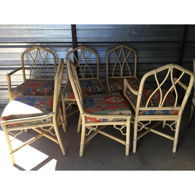 """This is a set of light colored bamboo dining chairs with an """"x-back"""" design and fretwork detail in each corner. There are..."""