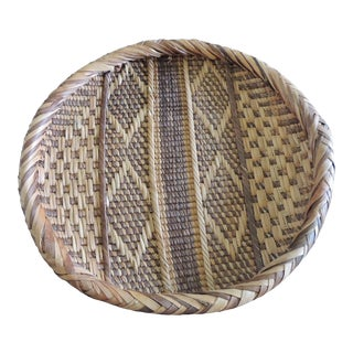 Round Natural and Brown Woven Tribal Basket With Braided Rim For Sale
