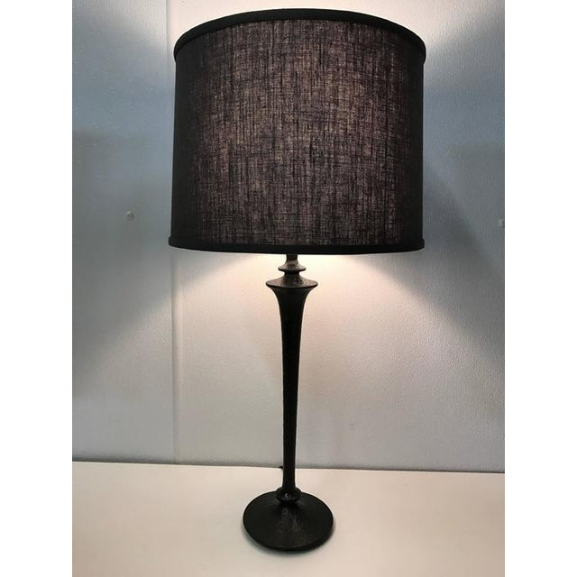Giacometti style patinated bronze table lamp. Shade for display purposes only.