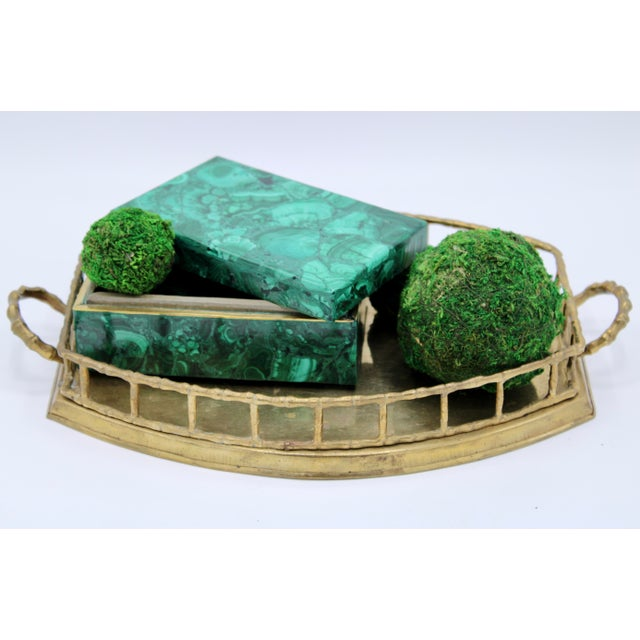 A superb brass tray with bamboo motif, circa 1960. This tray carries a nice weight, and is elevated by a unique pedestal...
