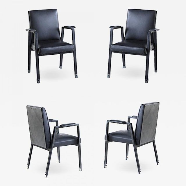 Jacques Adnet rare set of 4 black hand stitched leather arm chairs.