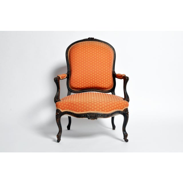 This handsome Louis XV style chair is from Paris France and is made from walnut wood late 1800s. The fauteuil piece...