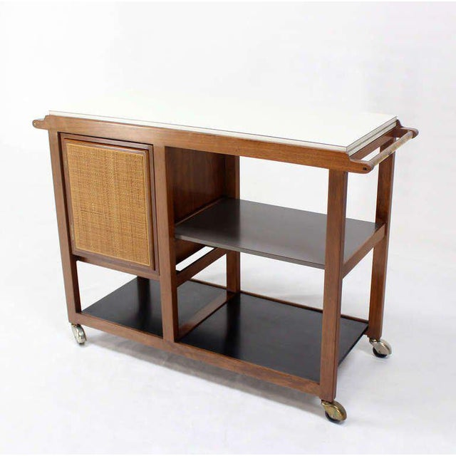 Very nice mid century modern flip top serving cart. Outstanding manufactiring quality and original condition. The cart has...