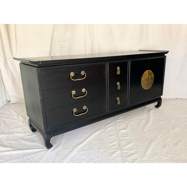 Mid Century pagoda style credenza/dresser. Made by Kent Coffey for the Amerasia line. Ming style legs with brass hardware...