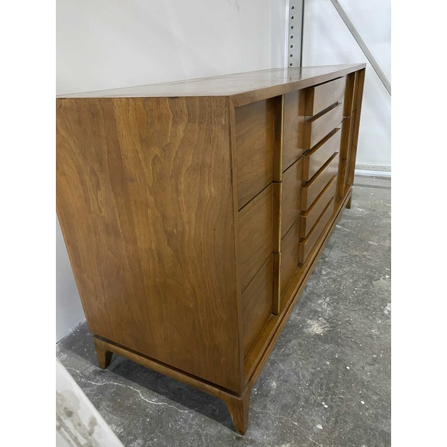 Classic American of Martinsville 9 Drawer Dresser with Brass Accents on the drawer pulls. Matching nightstands available!