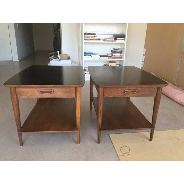 Amazing set! These side tables or nightstands have a mostly wooden finish but feature black top surfaces. Each has one...
