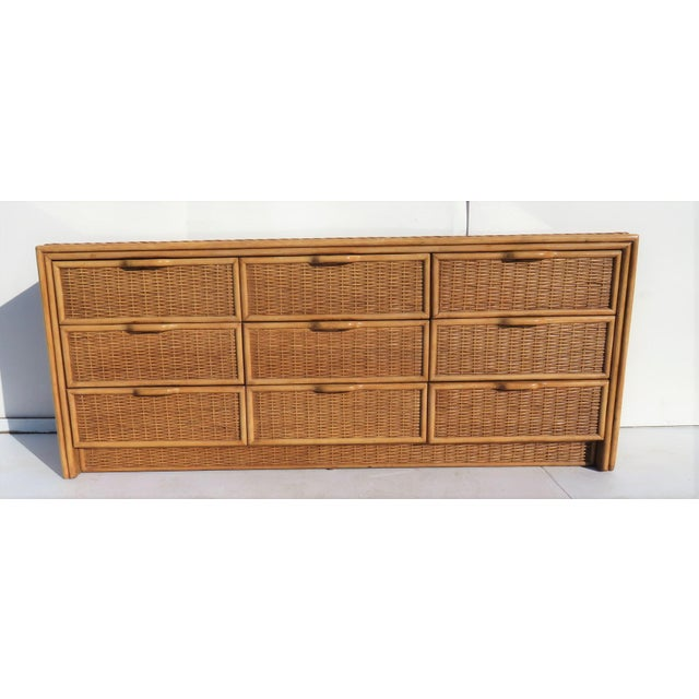 Bamboo frame with wicker sides top and drawers. Glass top. Light wear.