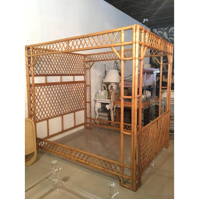 Amazing vintage Chinese Chippendale rattan queen-size canopy bed. Bed comes apart in four sections: Headboard, footboard...