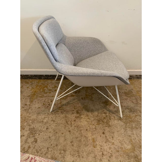 Modeled after the classic mid-century modern womb chair this reproduction vintage design offers a clean and chic modern...