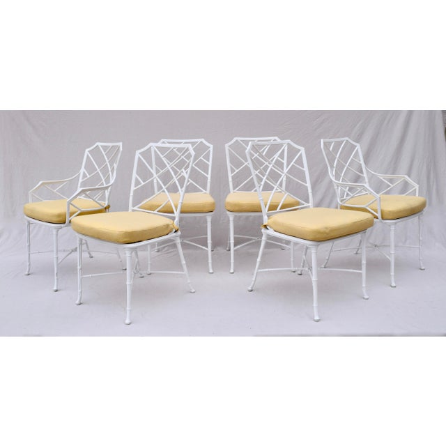 A rare find featured in our Brown Jordan Calcutta Oval Glass Top Umbrella Dining Table with two arm & four side chairs....