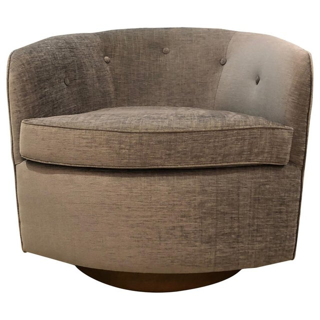 Pair of button backed lounge chairs shown in Saroma Plains chenille fabric (bluebell) on walnut swivel base. Available as...