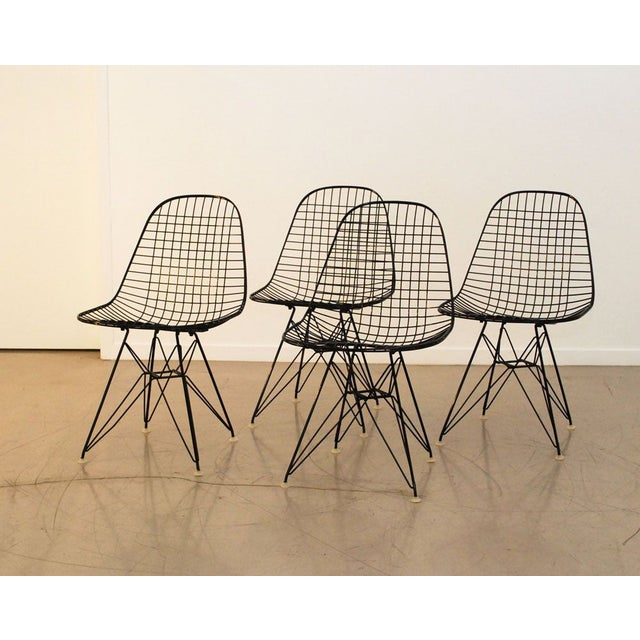 Every MCM lover's dream! This is a set of 4 original Eames wire chairs with Eiffel Base have been fully restored at the...