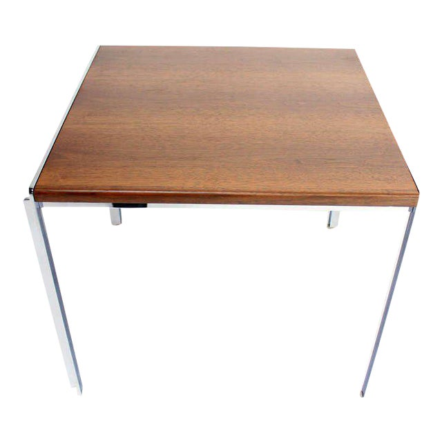 Very nice mid-century modern walnut and chrome side table. Made in the mid 20th century.