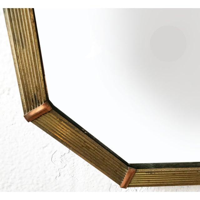 "Circa 1950s very elegant Italian trapeze mirror with a brass frame. 25'W top, 20""W base"