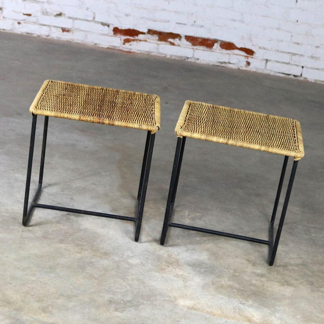 Handsome pair of wrought iron and rattan mid-century modern side tables in the style of Calif-Asia. They are in wonderful...