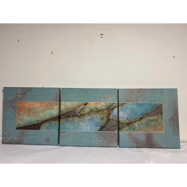 """Three-piece mixed media painting. Signed. Blues browns and metallic colors. Each Canvas Is 24"""" x 24""""."""