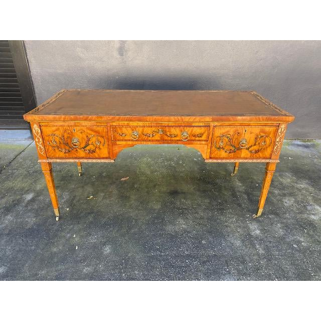 Fine early 19th c. English painted satonwood desk with leather top.
