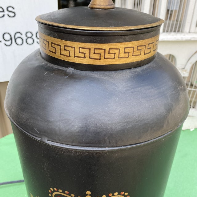 Gorgeous black metal lamp with Greek key details. It is 32 inches in height and the actual lamp from bottom to top of...