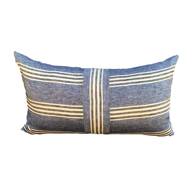 Blue linen, imported from Europe, with classic black and white stripes. The heavy black zipper closure adds casual...