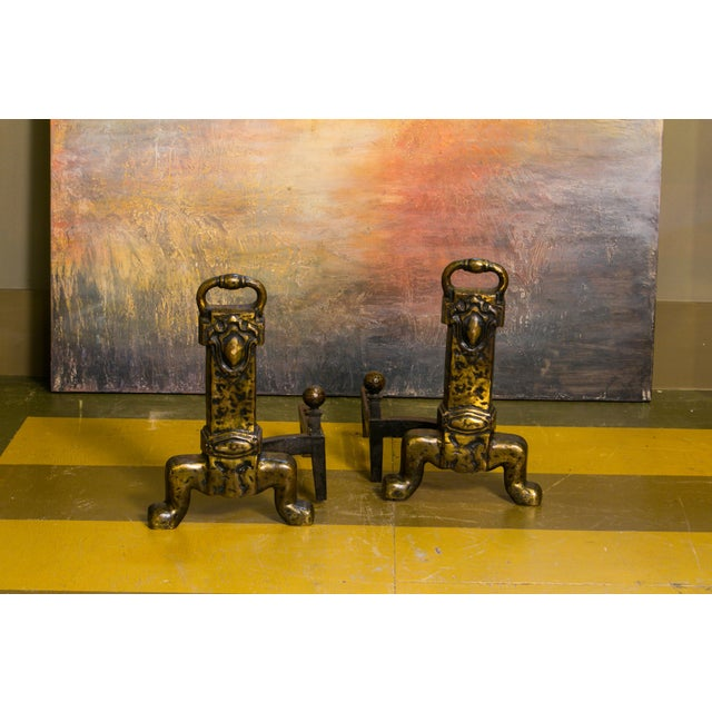 A truly unusual and unique item. Heavy cast bronze andirons in the Arts and Crafts style. Unlike anything we have ever...