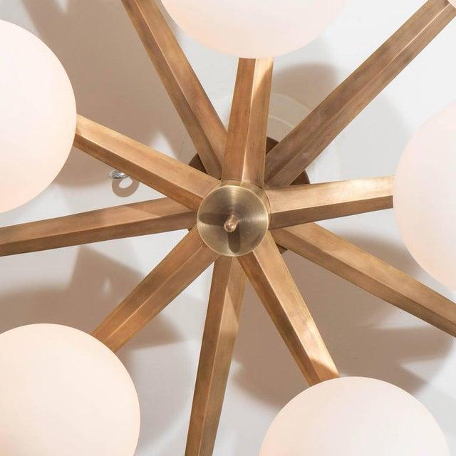 Custom antique brass ten-globe ceiling light.
